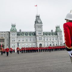 A graduating Cadet stands at attention as the Royal Military College of Canada Cadet Wing perform a Feu de Joie to salute the graduating class in Kingston , 15 May 2015.